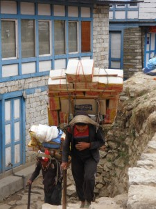 Sherpas carrying a heavy load