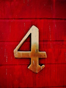 The number 4 on a red background.